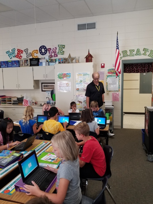 Third graders using technology.