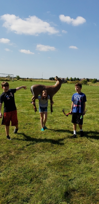 Middle School students carrying a deer target.