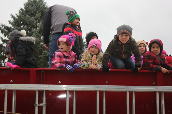 Students riding back to school on the fire truck.