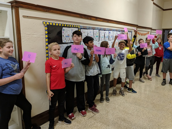 Mrs. Hajewski's sixth graders continued practicing punctuating dialogue by building human sentences. #WalworthJ1
