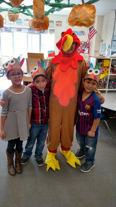 Students and student dressed as turkey
