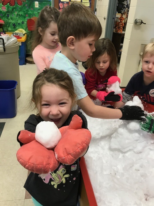 The children in Ms. Boldger's junior kindergarten class playing in the snow!