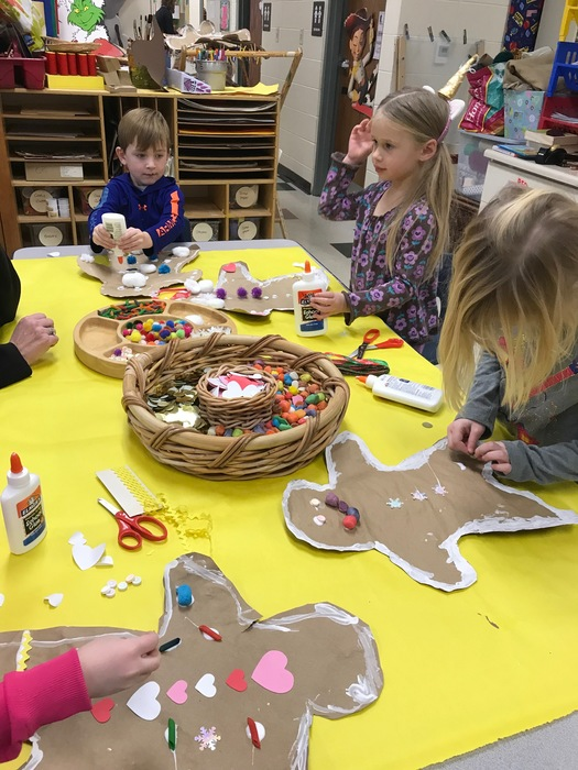 The children in Ms. Boldger's junior kindergarten class making gingerbread men!