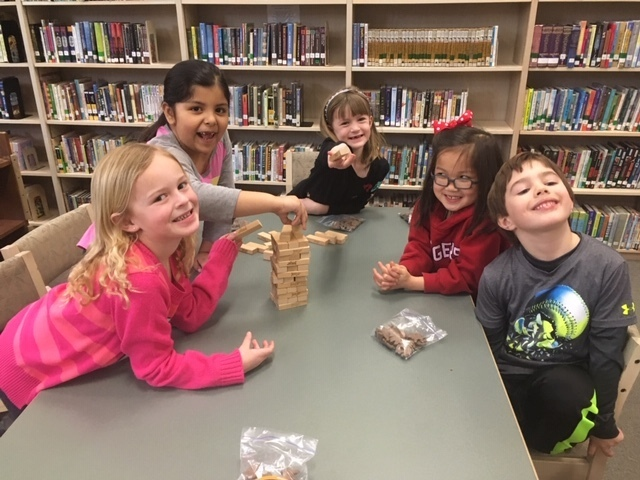 Sarah Krusinski and friends had fun playing Jenga and Ring It with Mrs Weborg.