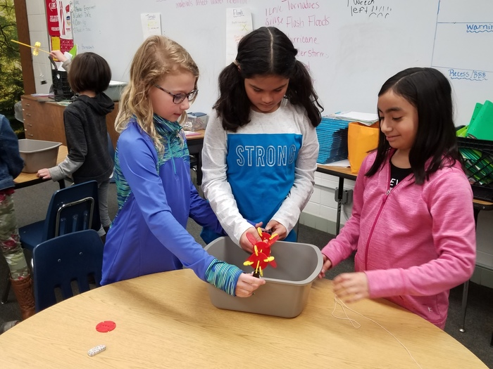 In Mrs. Schauf's third grade science class the students are wrapping up their unit on water and climate. They are using the Engineerring/Design Process to create water wheels that use the energy from the water to lift a load.  #WalworthJ1