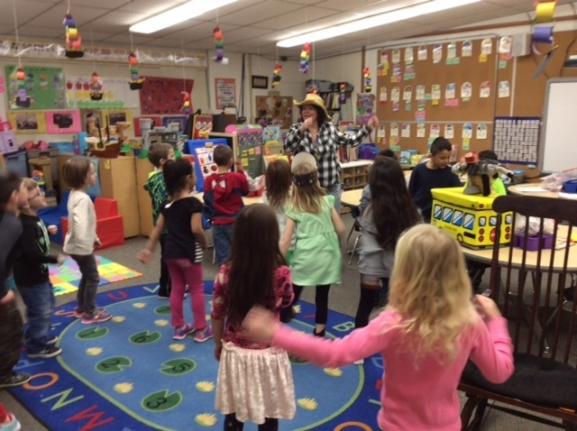 "Our junior kindergarten and kindergarten classes enjoyed a fabulous visit from Mrs. Danell Craig, with the Dousman Bus Company. She read the very funny and interactive story ""The Wonky Donkey"" and everyone loved it. Then they had a blast dancing to the song-version of the book! #WalworthJ1"