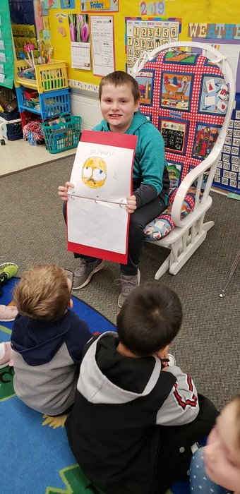 "This student is a fine example of taking his talent for drawing and using it to educate younger students!  He created an ""emoji"" feelings book and led a class discussion about not only his talent, but also the importance of sharing feelings with others!"