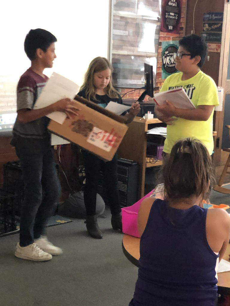 "The 5th grade is practicing their comprehension and speaking skills by preparing a retelling of the story, ""A Package for Mrs. Jewls."" They planned, wrote, rehearsed, and performed their retelling! It was great fun!"