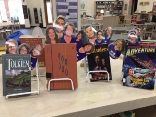 "Students this week are being greeted by the smiling faces of Walworth staff members poking out of their favorite books! Happy to say, many of these books have already been checked out, just because a favorite staff member ""recommended"" it!"
